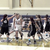 Junior forward Katie Edwards slips past a line of Finlandia players.