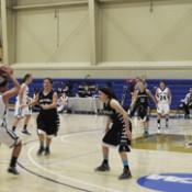 Freshman forward Becca Heup tries to pass to an open teammate.