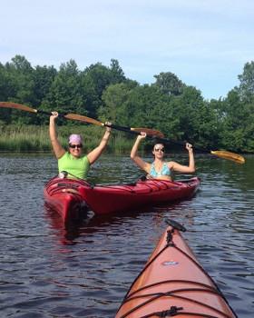 Leea Glasheen  and her daughter Jasmine, kayak a river near Sheboygan that leads into Lake Michigan.